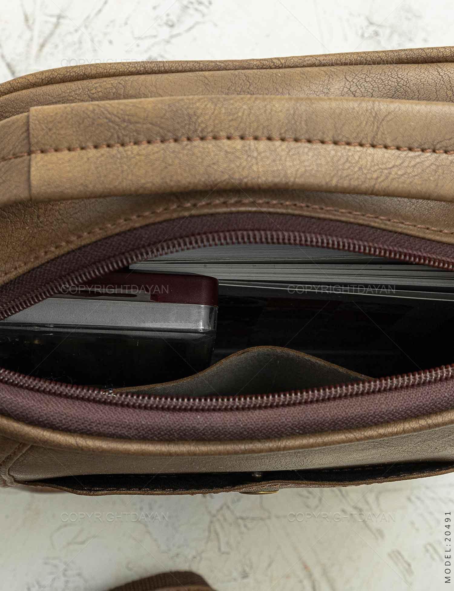 ست کیف دوشی و کیف پالتویی Cat مدل 20491 ست کیف دوشی و کیف پالتویی Cat مدل 20491 149,000 تومان